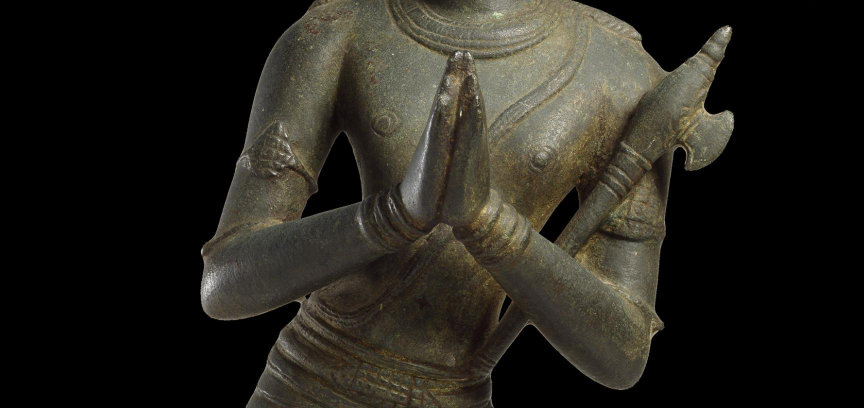 Close-up on hands figure of Hindu Saint Chandikeshvara, showing gesture of respectful salutation.