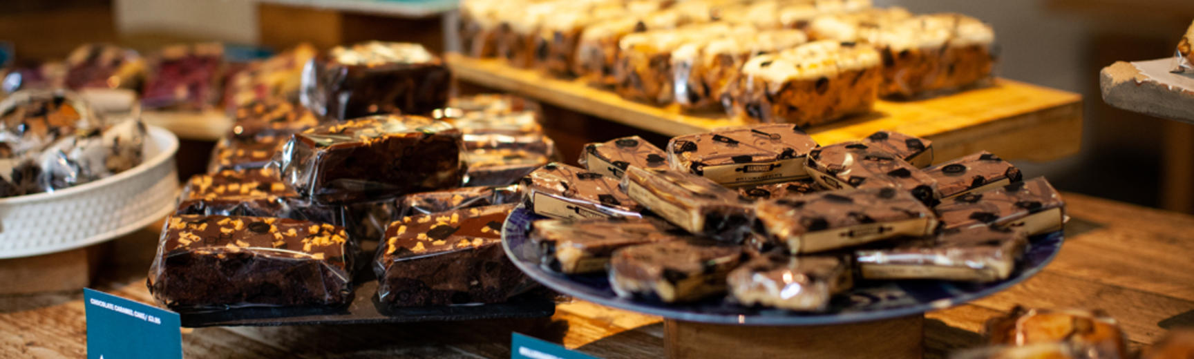 Brownies and cake slices displayed on a table