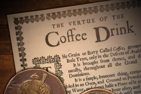 Two copper coins on top of a page titled The Vertue of the Coffee Drink