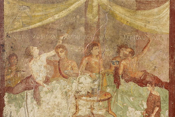 Fresco painting of five people are a Roman Dinner party with a slave waiting on them