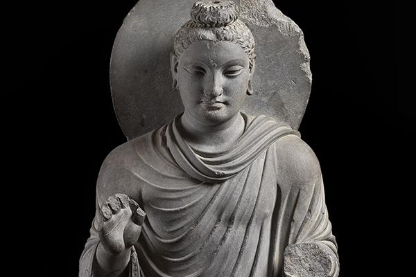 grey stone statue of the buddha at the ashmolean