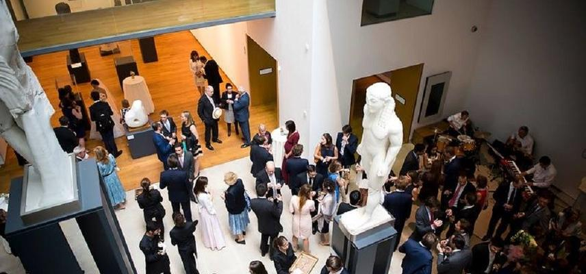 View of the museum's atrium full of people at an event