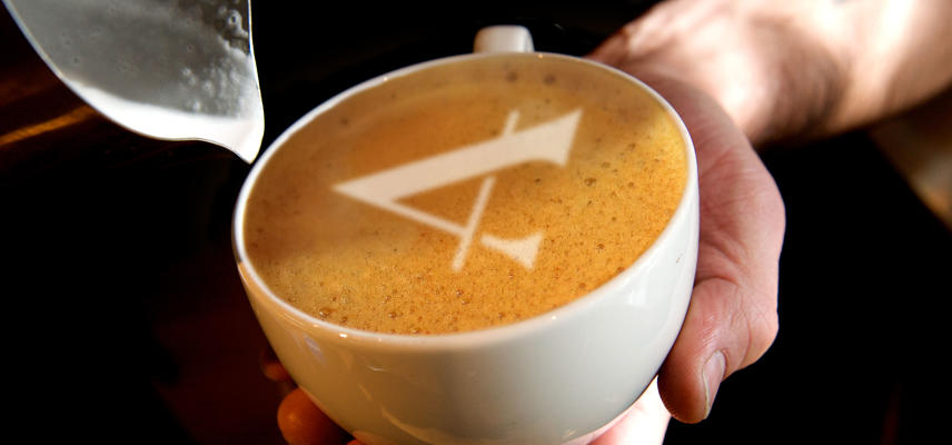 A coffee with the Ashmolean A-logo