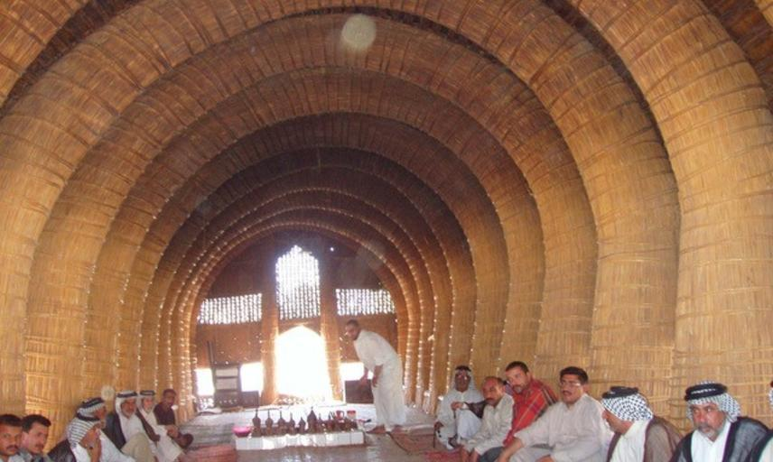 Marsh Arab men inside an Iraqi reed mudhif (village hall)