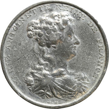 white metal medallion